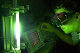A development engineer adjusts the electrical parameters of the special light of the light irradiation device therapy