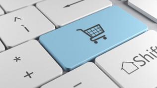 Ein Icon eines Einkaufswagens auf einer Taste der Tastatur