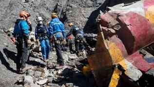 Search and rescue workers collecting debris at the crash site of the Germanwings Airbus A320 in the French Alps, above the town of Seyne-les-Alpes, southeastern France, 31 March 2015.