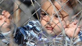 An illegal immigrants' child is seen in a detention center in Kyprinos, in the region of Evros, at the Greek-Turkish border