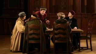 Kaufleute der Ravensburger Handelsgesellschaft am Tisch versammelt (Spielszene).