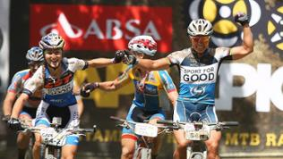 Germany's Sabine Spitz (R) and Ukraine's Yana Belomoina (L) of Team Sport for Good celebrate while crossing the finish line