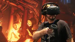 An attendee uses Bethesda' Virtual Reality (VR) headset to play science fiction horror first-person shooter video game 'Doom' at the E3