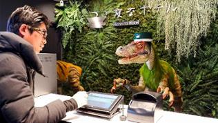 A dinosaur robot greets a guest at a reception of the newly opened Henn na Hotel