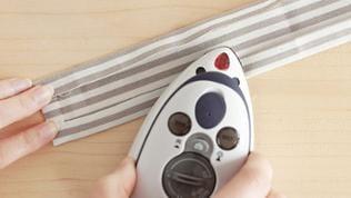 Stoffzugabe an den langen Seiten und einer kurzen Seite umbügeln.