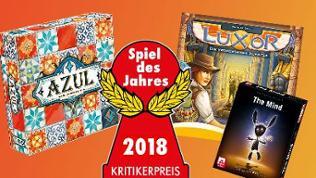 """Schachteln der zum """"Spiel des Jahres 2018"""" nominierten Spiele """"Azul"""", """"Luxor"""" und """"The Mind"""""""