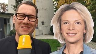Jochen Stöckle spricht mit Stephanie Anhalts Pappfigur vor dem Stuttgarter Fernsehturm.