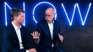 Die BMW- und Daimler-Chefs Harald Krüger und Dieter Zetsche präsentieren das neue gemeinsame Unternehmen.