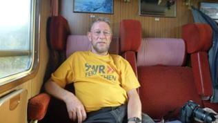 """Wolfgang unterwegs mit der Sonderfahrt im Jahr 2013. Während einer früheren Sonderfahrt traf er auch auf seine Ione. Eine echte """"Eisenbahn""""-Romantik."""