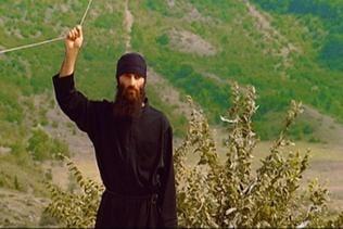 Mönch zieht Seil - Glocke
