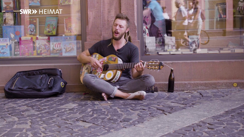 Jacob macht Straßenmusik
