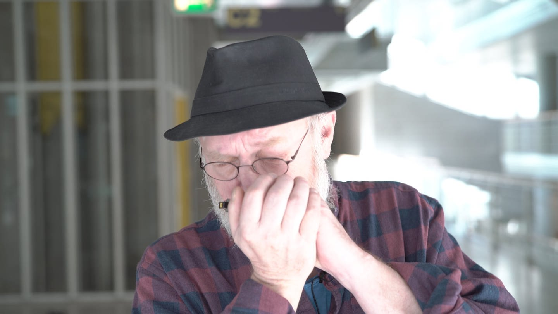Mann mit Hut und Mundharmonika (Foto: SWR)