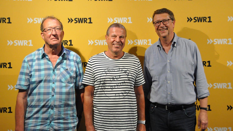 Die SWR1 Hitparaden-Macher Jürgen Rathfelder, Hans-Peter Archner und Christoph Mohr