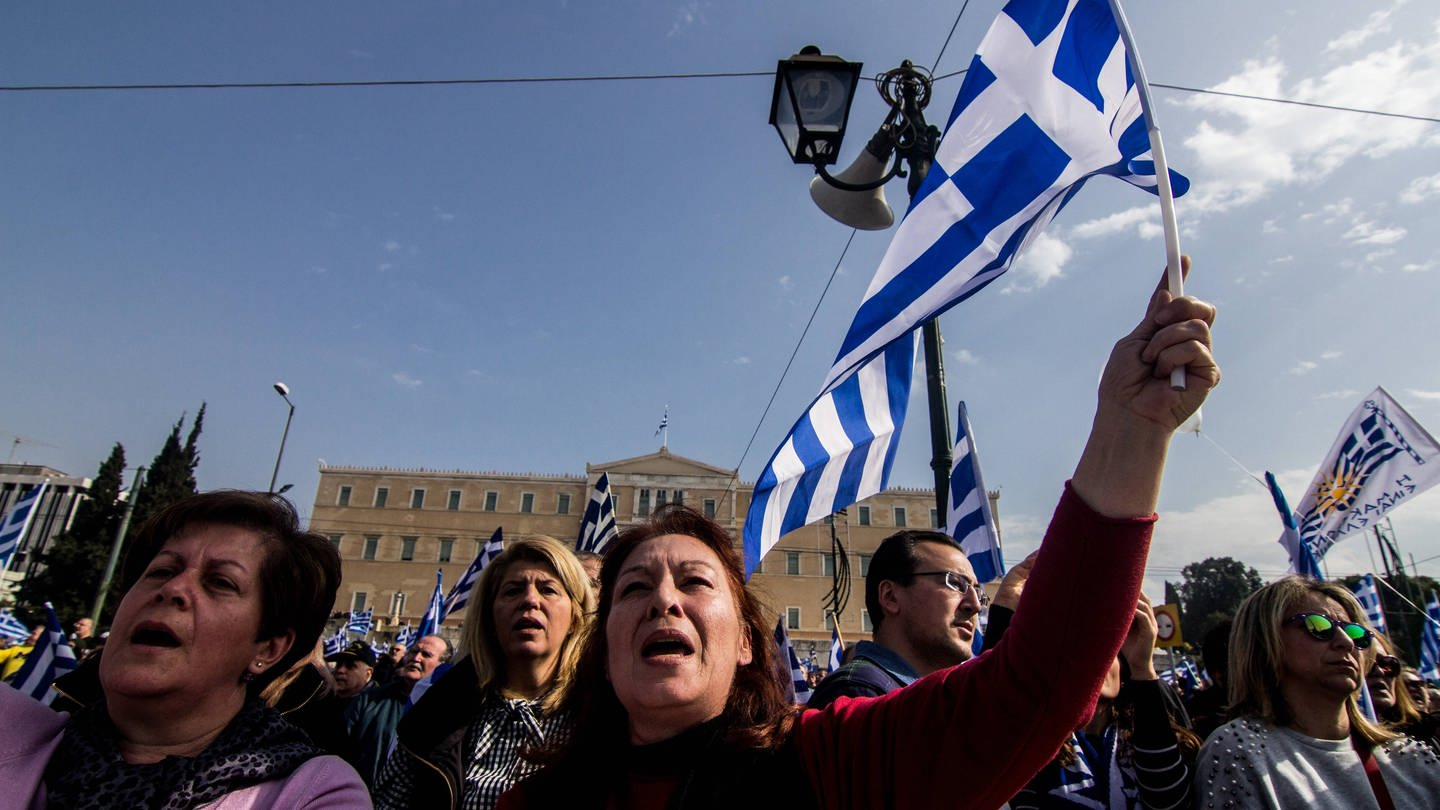 Greece: Demonstrate against the use of Macedonia A woman is seen singing the Greek Anthem during the demonstration