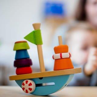 Ein Kind spielt in einer Kindertageseinrichtung (Foto: dpa Bildfunk, picture alliance/Rolf Vennenbernd/dpa)