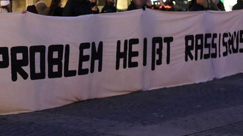 Demonstranten mit Banner