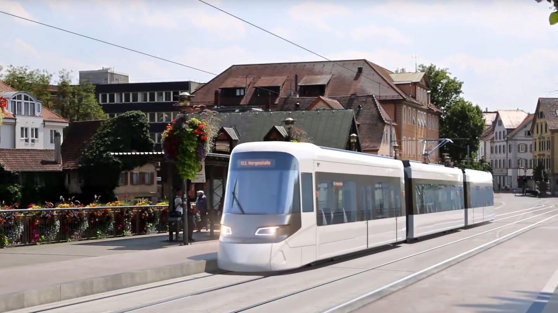 Eine Fotomontage zeigt einen Zug der Regionalstadtbahn Neckar-Alb auf der Tübinger Eberhadsbrücke.