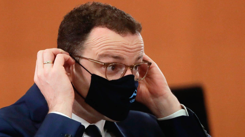 Jens Spahn zieht Maske auf (Foto: picture-alliance / Reportdienste, picture alliance/Markus Schreiber/AP-Pool/dpa)