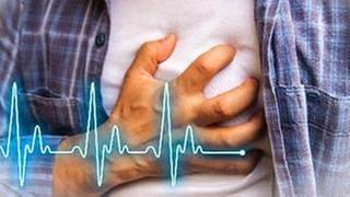 Mann greift sich ans Herz (Foto: Getty Images, Thinkstock -)